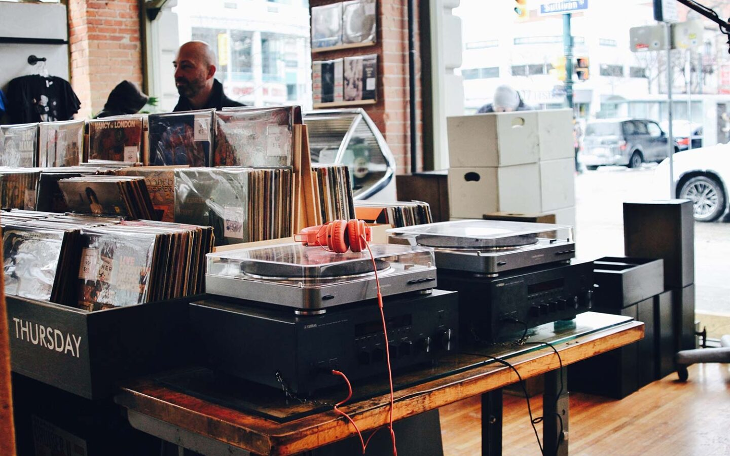inside of a music store with records and record players on display