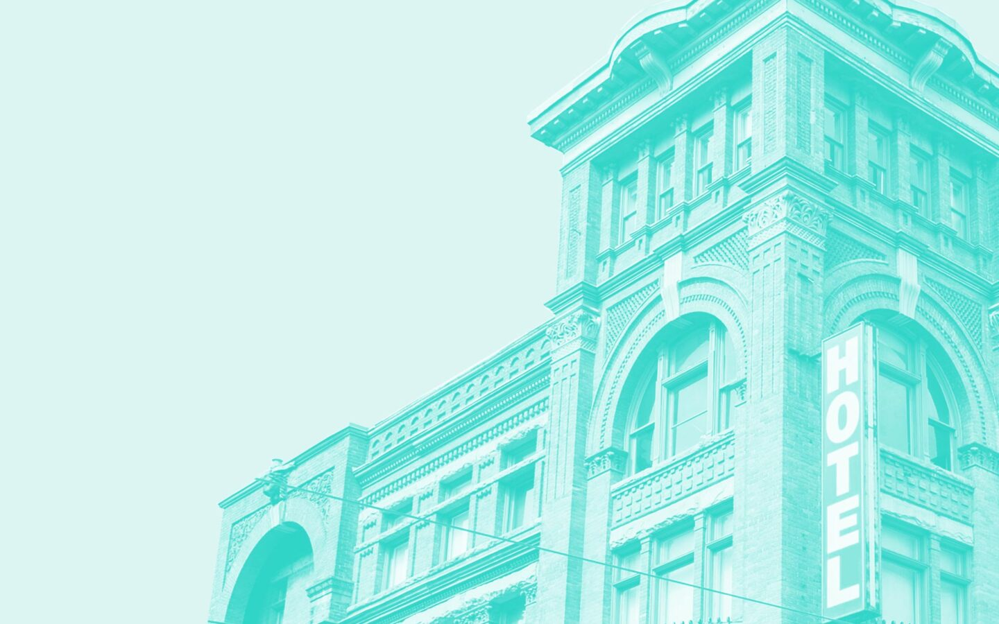 blue cutout exterior image of a heritage brick boutique hotel